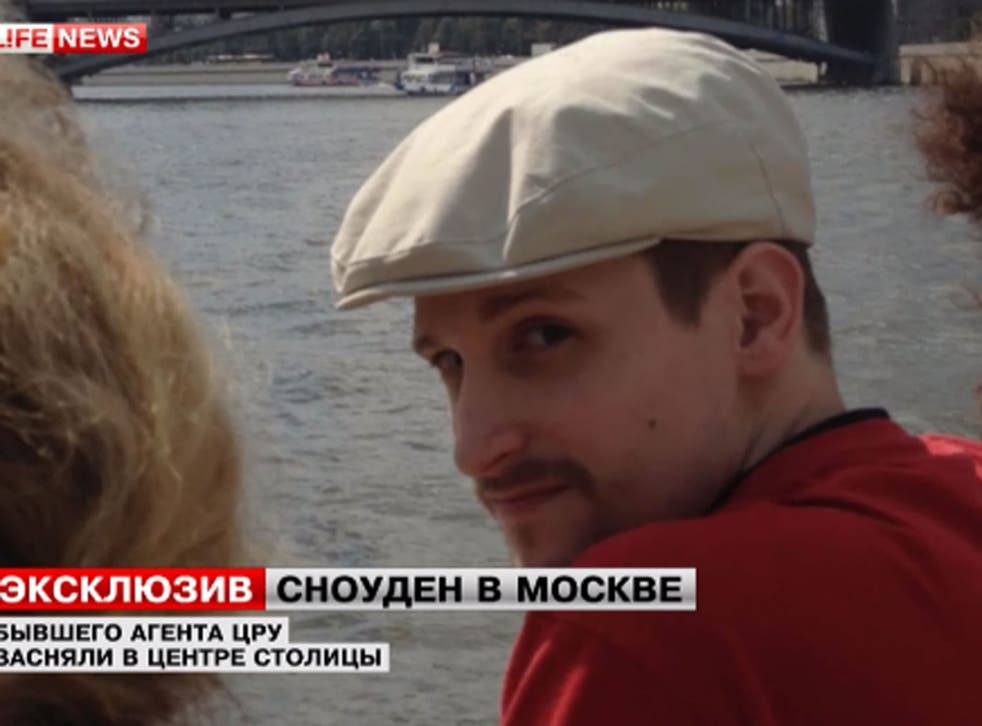 Edward Snowden, pictured here seeing the sites of Moscow, has found a job on a Russian website, his lawyer says