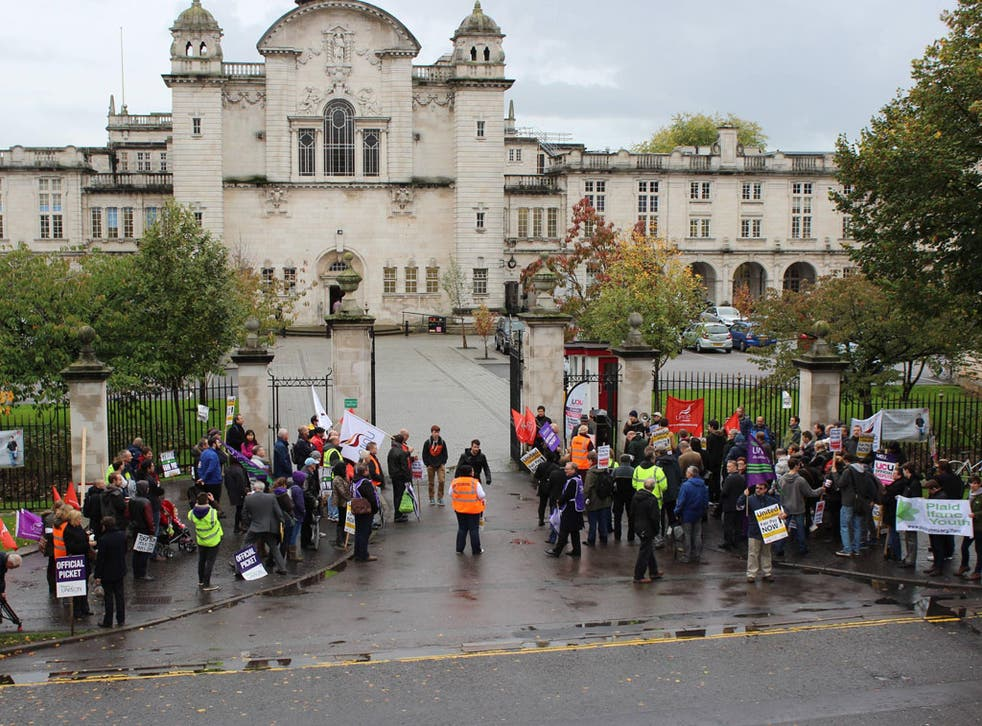 Protesters gather at the gates to Cardiff University