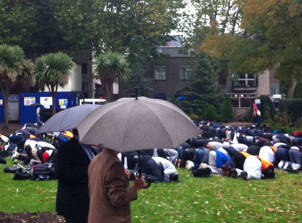 Muslims at Queen Mary University, London, praying in the rain