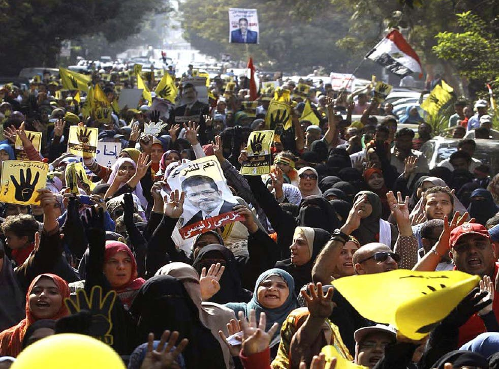 Supporters of Mohamed Morsi, below, are gather expected to gather today in protest