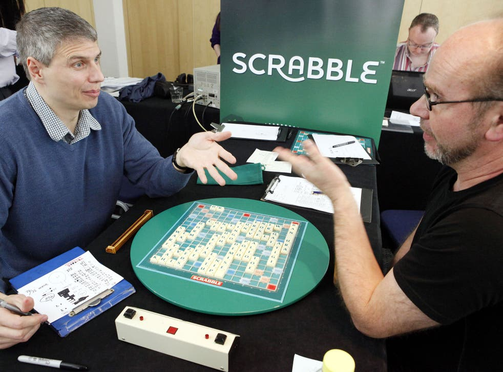 Paul Allan, left, discusses his winning board with defeated opponent Allan Simmons, right, at the 42nd British National Scrabble Championships in London