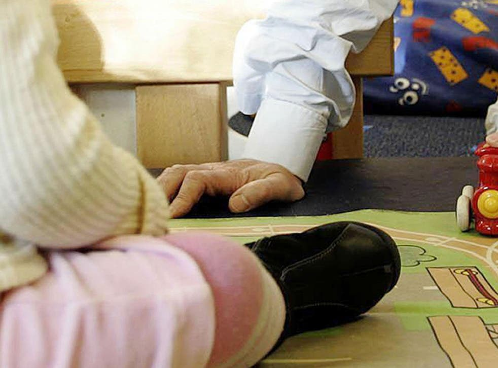 An adult playing with a child at a nursery - a senior Ofsted officer says children should be admitted to school from the age of two to eradicate the effects of poverty on their performance
