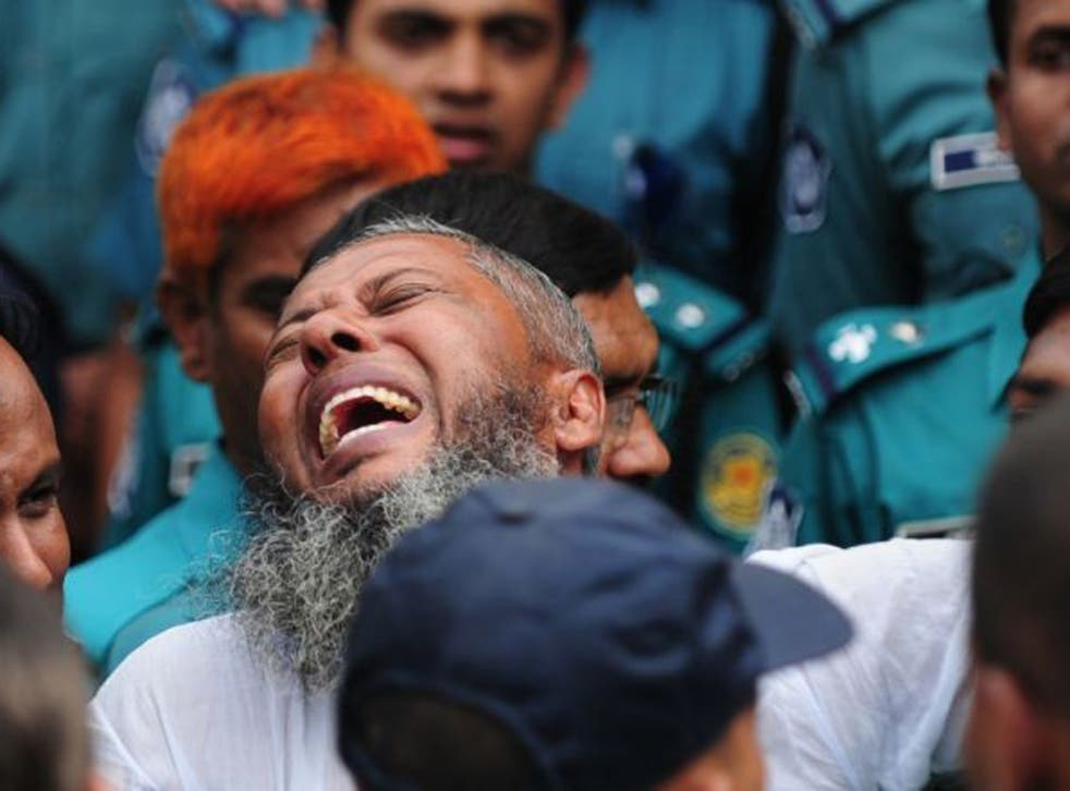A Bangladesh Rifles soldier gestures following the announcement of his death penalty at the special court in Dhaka as it sentenced at least 150 soldiers to death over a 2009 military mutiny