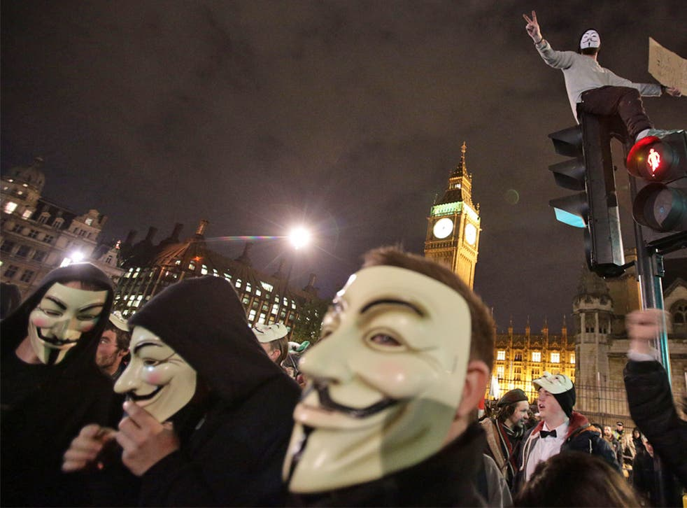 Protesters demonstrate as part of the Bonfire of Austerity protest outside the Houses of Parliament