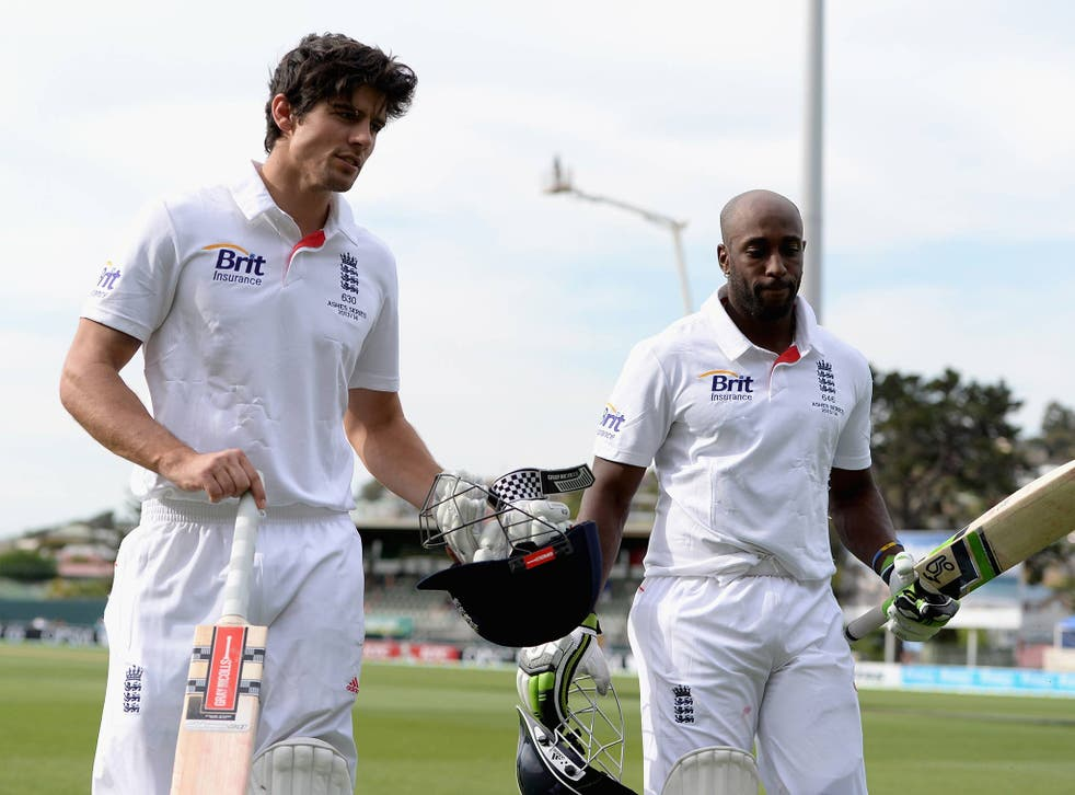 England captain Alastair Cook and Michael Carberry salute the crowd as they leave the field at the end of day one of the tour match between Australia A and England