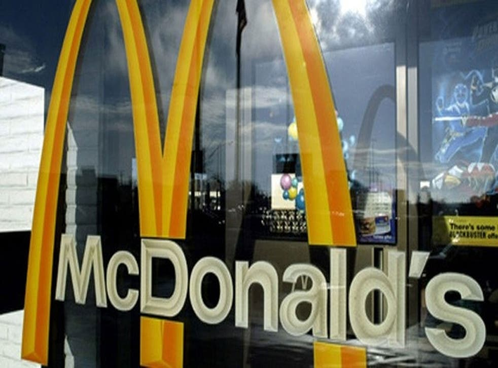 A woman has been arrested after she drove over her boyfriend three times because he refused to take her to McDonald's.