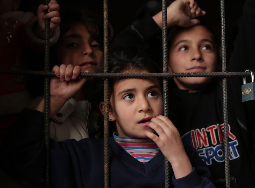 Refugee Syrian children wait for a medical check up in a corridor of newly opened refugee camp in an old school in Sofia, Bulgaria – a gateway to the European Union for migrants fleeing Syria via Turkey
