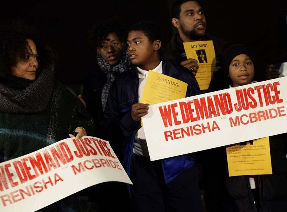 Demonstrators protest against the killing of 19-year-old Renisha McBride outside the Dearborn Heights Police Station in Dearborn Heights, Michigan November 7, 2013.