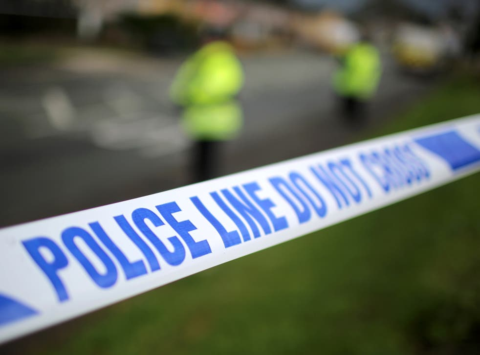 Police say they have arrested a serving British soldier after a 'suspicious device' was found at a home in Salford