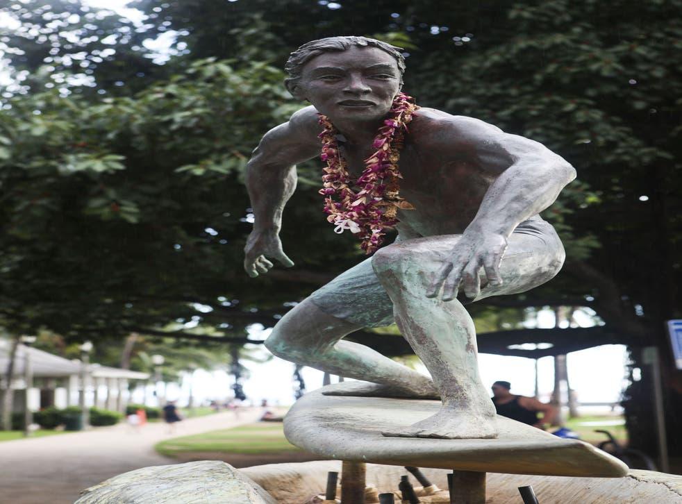 A statue of surfing legend Eddie Aikau, Honolulu