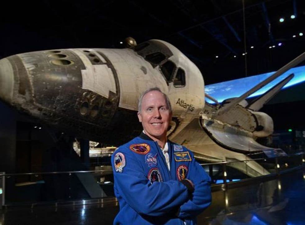 Walk this way: astronaut Tom Jones in front of a space shuttle. He was on four space shuttle missions and completed three space walks