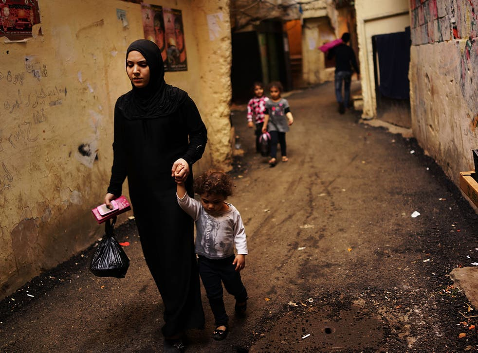 A Syrian woman and her child in Beirut
