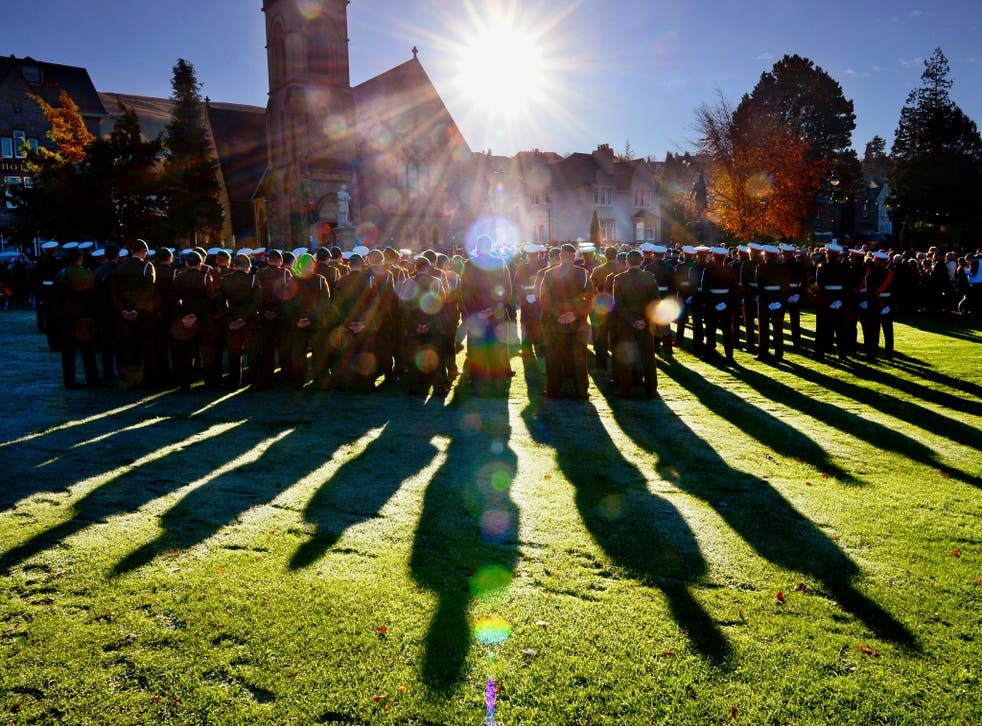 Members of Scotland's armed forces and veterans gather to commemorate and pay their respects in Fort William