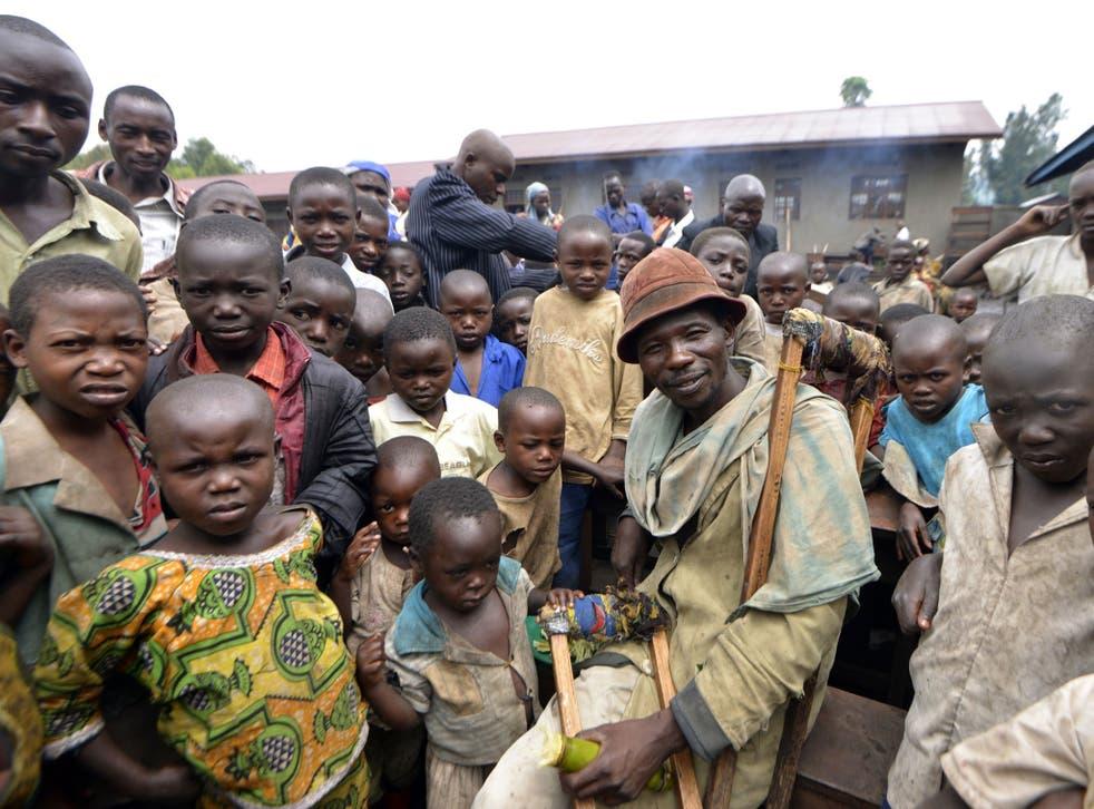 Internally displaced people gather at the Mbuzi hilltop near Rutshuru
