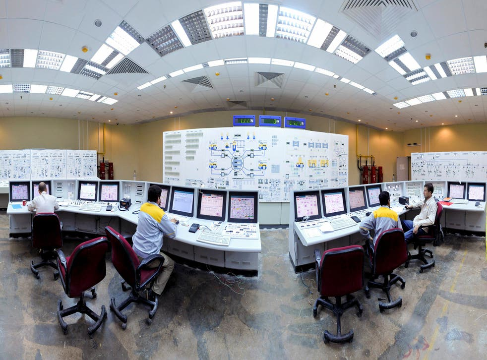 Russian (L and R) and Iranian operators monitor the nuclear power plant unit in Bushehr, about 1,215 km (755 miles) south of Tehran.