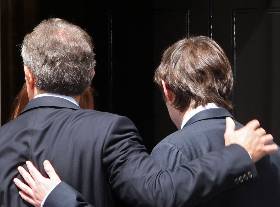 Tony Blair embraces his son Nicky as he walks out of Downing Street for the last time in June 2007