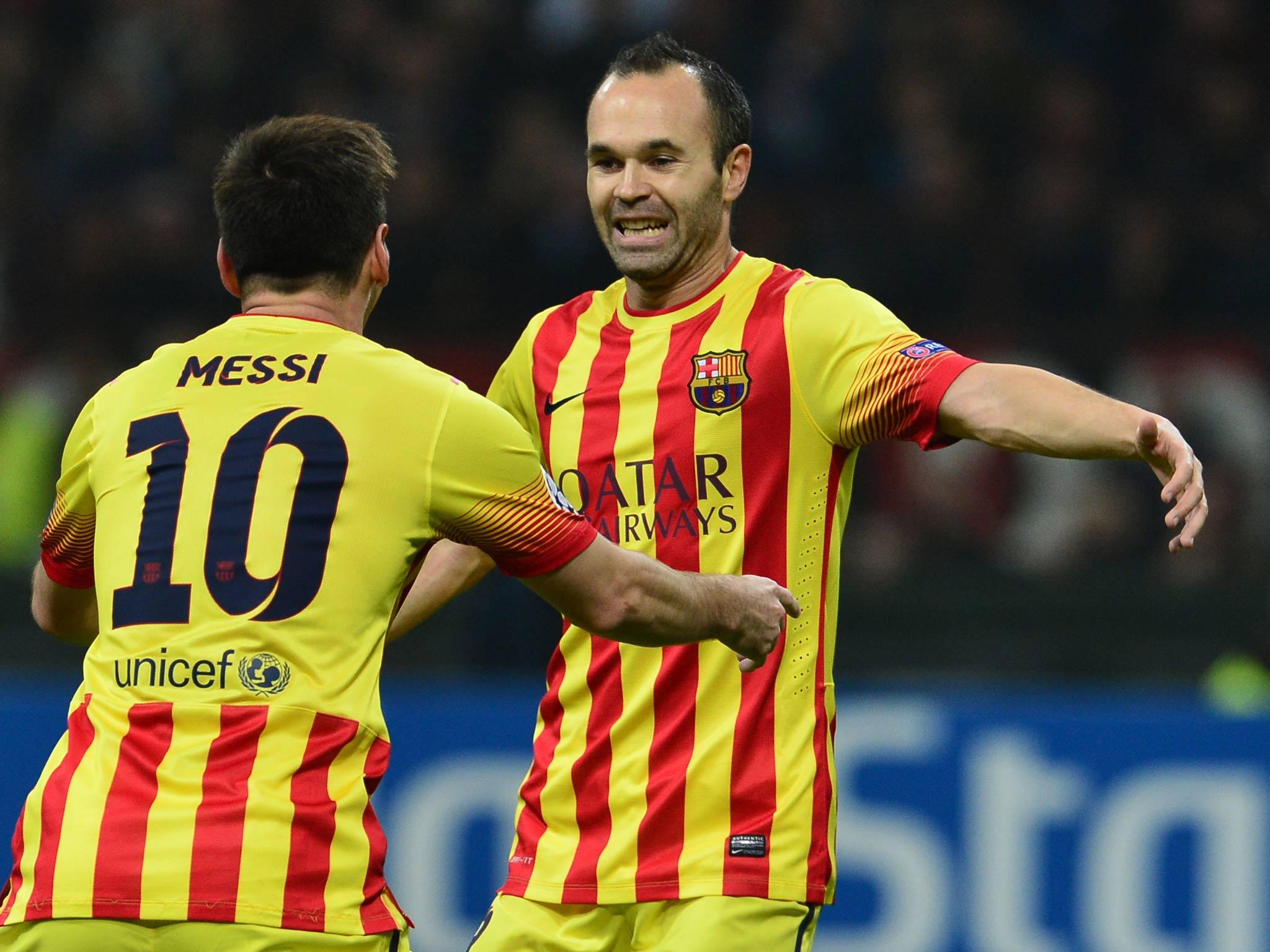 Barcelona midfielder Andres Iniesta signs three year contract