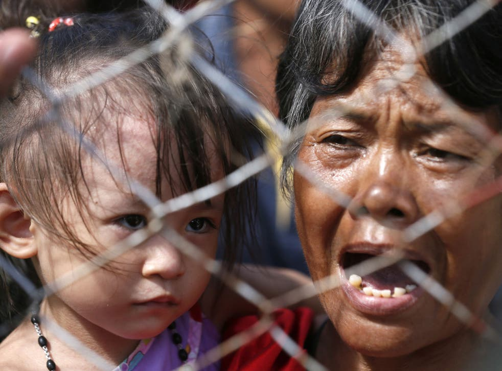 Survivors wait to be airlifted to Manila