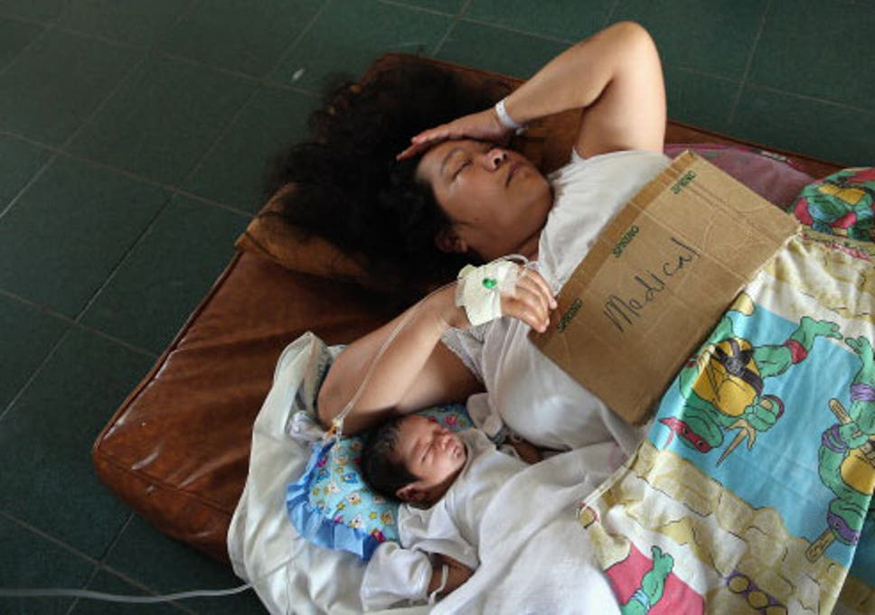 1149718f434 A mother and her infant await medical care after Typhoon Haiyan struck the  Philippines
