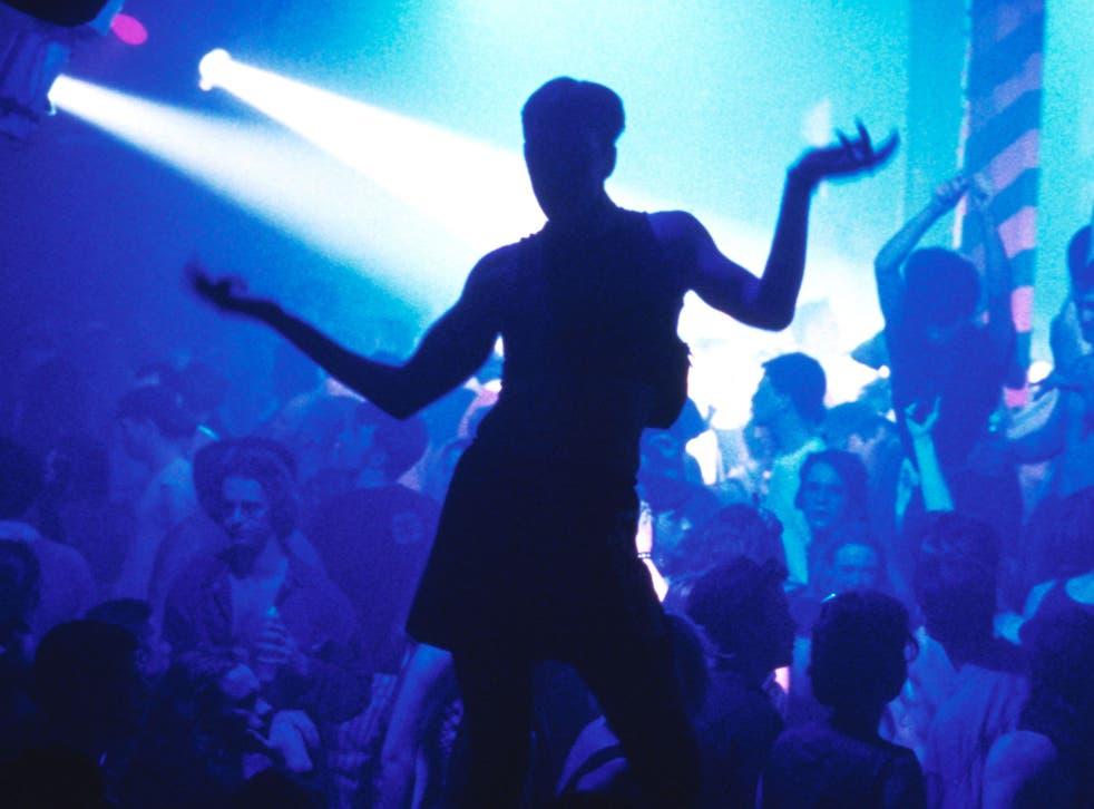 Silhouette of clubber dancing Hacienda nightclub