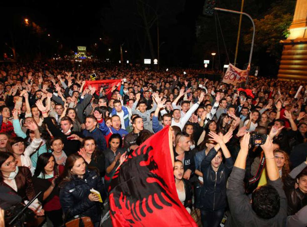 Thousands of Albanians celebrate Prime Minister Edi Rama's announcement that Albania will not host destruction of Syria's chemical weapons stockpile