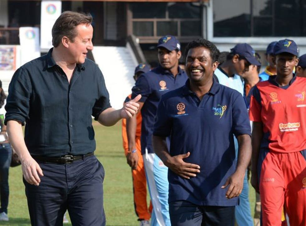 Sticky wicket: David Cameron with cricketer Muttiah Muralitharan