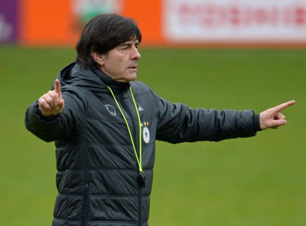 Joachim Low points the way for Germany during training in Barnet as they prepare to face England at Wembley on Tuesday night