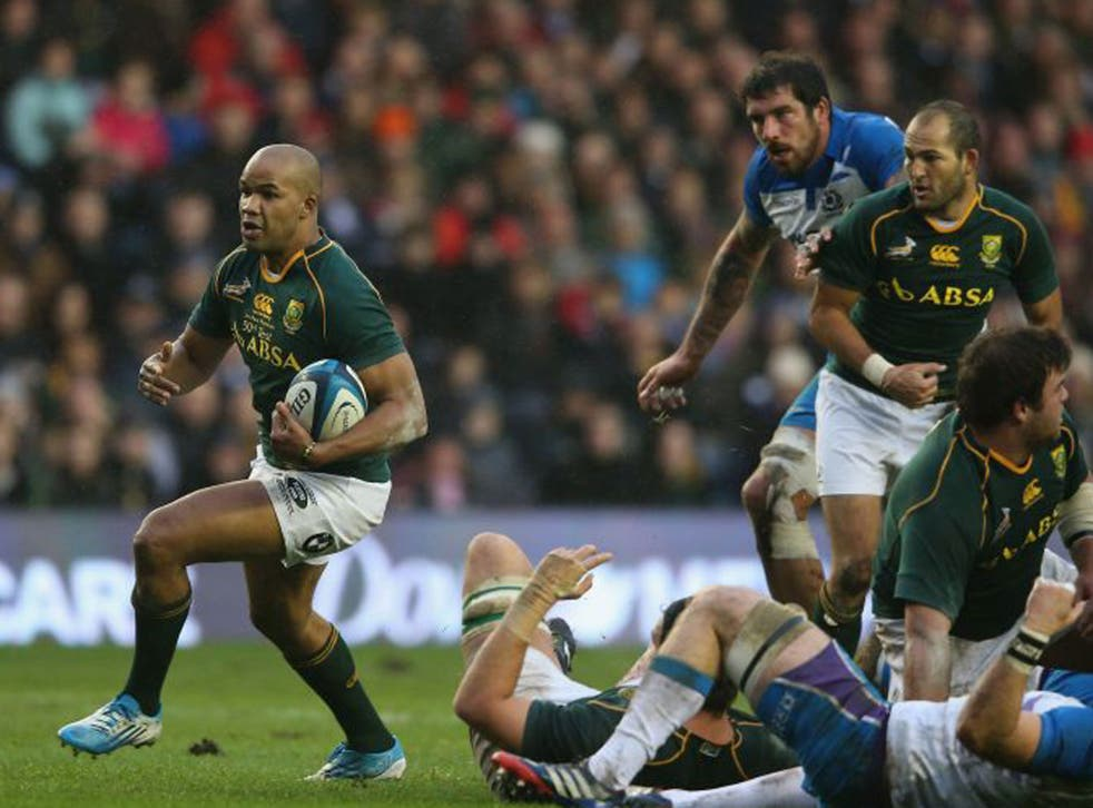 JP Pietersen of South Africa charges upfield in the 28-0 victory over Scotland