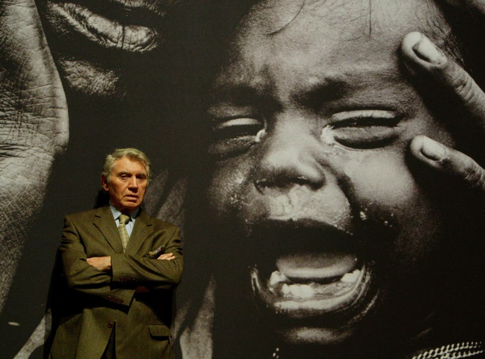 Don McCullin, pictured in front of one of his powerful war pictures, says he wishes he had spent more of his life taking photographs closer to home