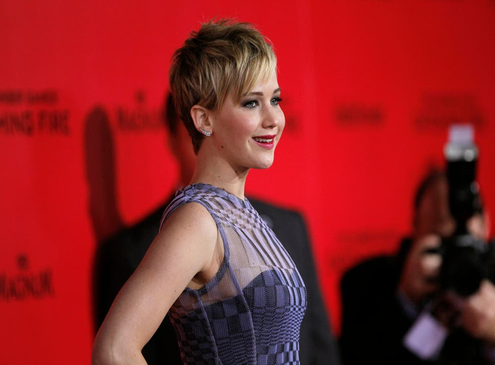 Jennifer Lawrence hits the red carpet at the LA premiere of 'The Hunger Games: Catching Fire'