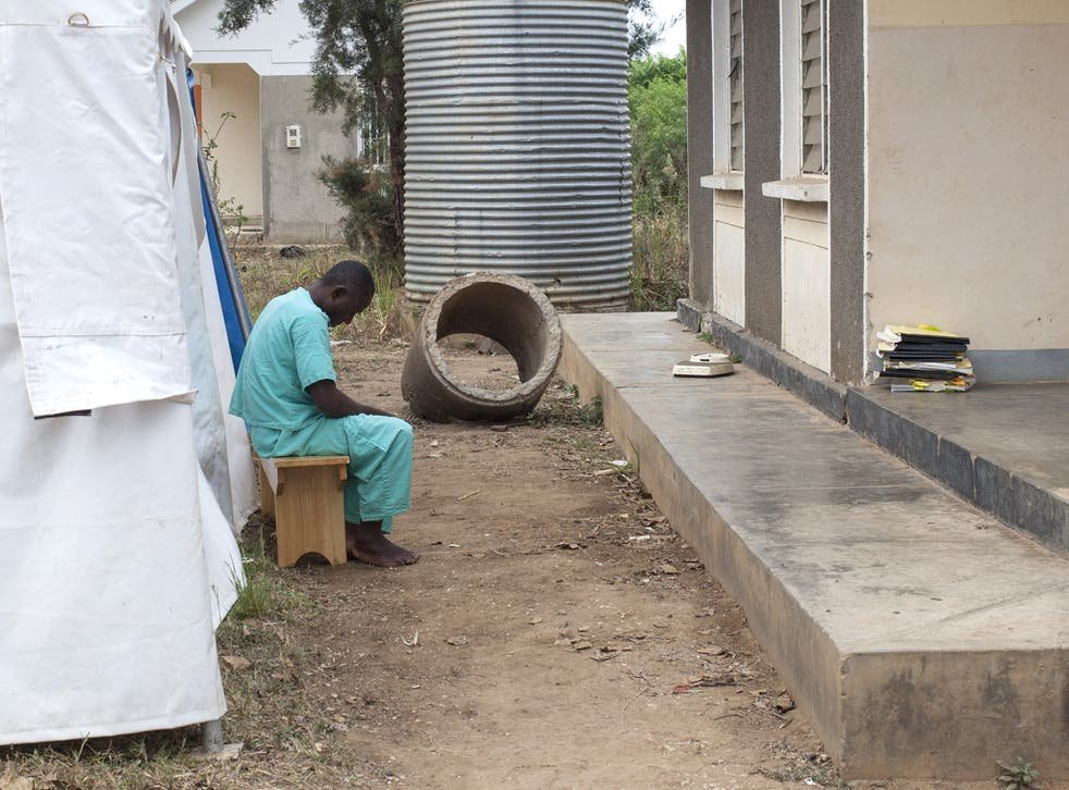 A patient waits for his circumcision in Uganda