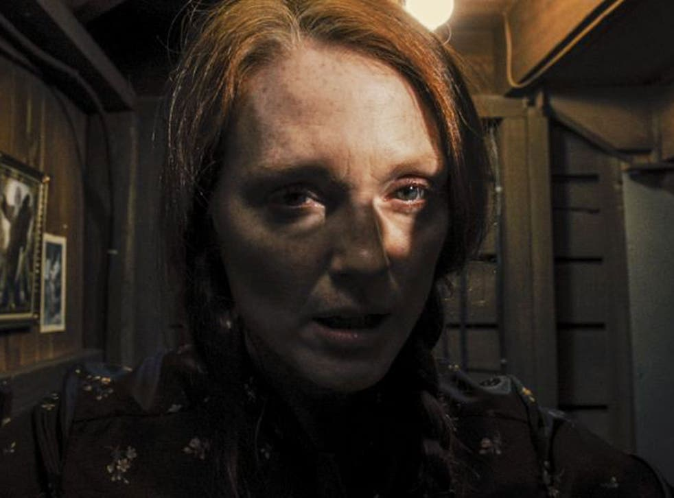 In the shadows: Julianne Moore as Margaret White in 'Carrie'