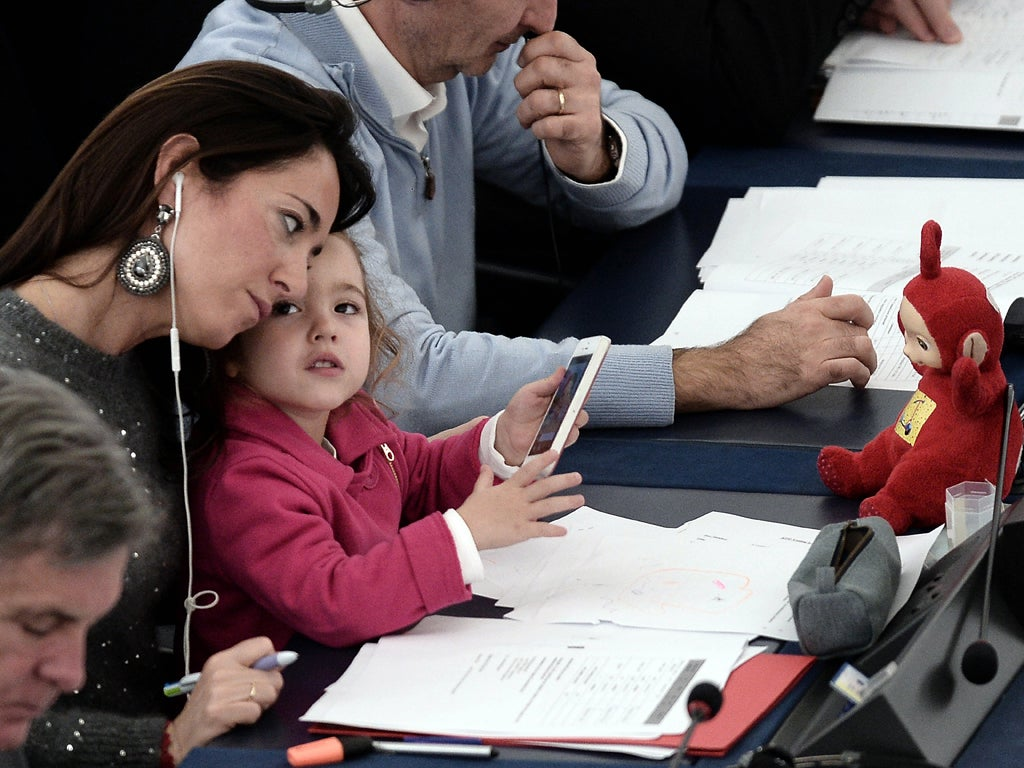 The Italian MEP who brings her daughter to work is highlighting the stark choice facing many women: career or motherhood?