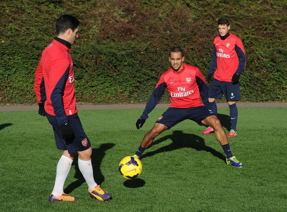 Mikel Arteta, Theo Walcott and Mesut Ozil at training