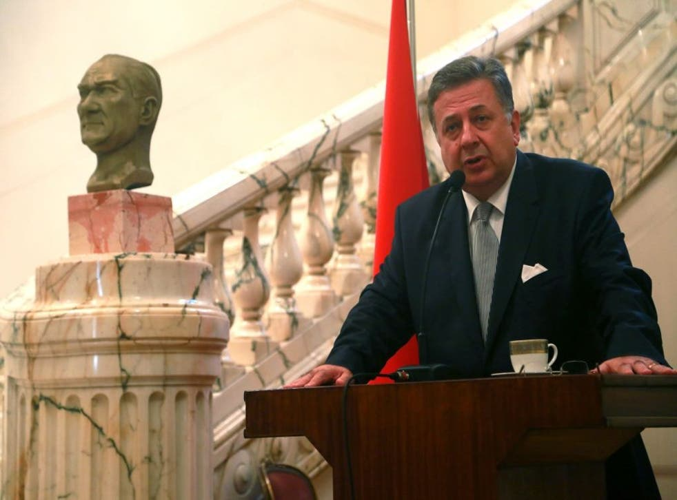 Turkish Ambassador to Egypt Huseyin Avni Botsali speaking during a ceremony at the Turkish Embassy in Cairo, Egypt, 10 November 2013