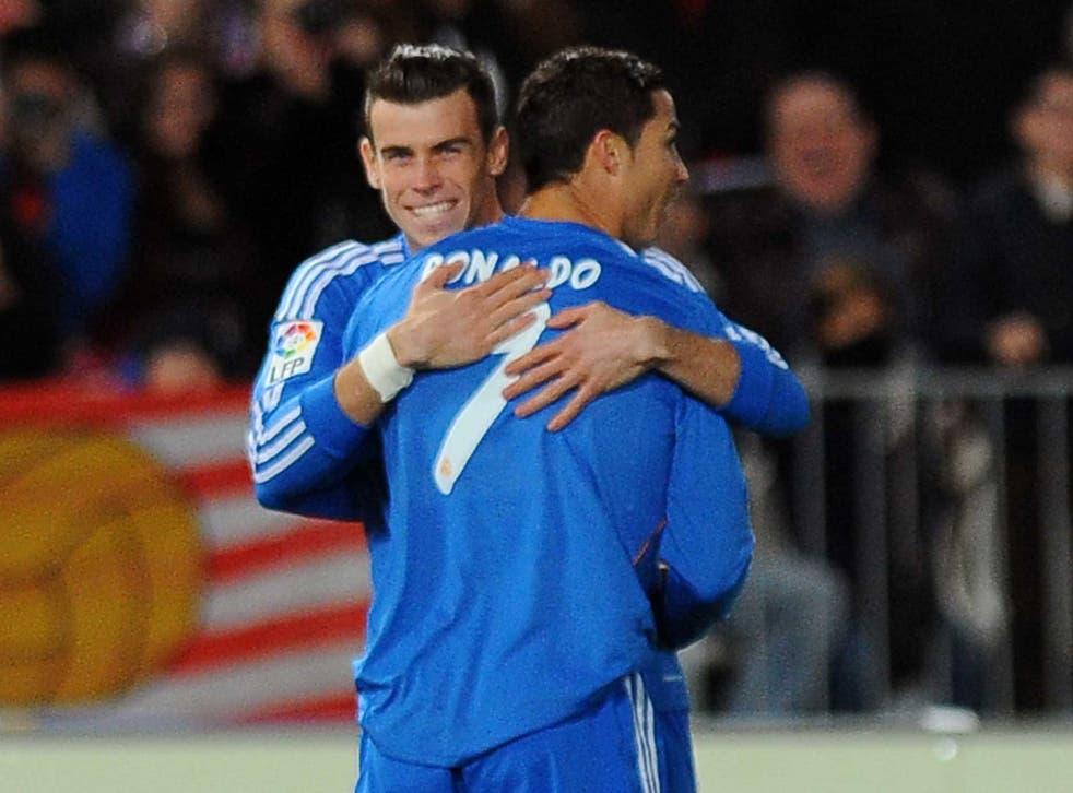 Gareht Bale and Cristiano Ronaldo share a hug during a recent game