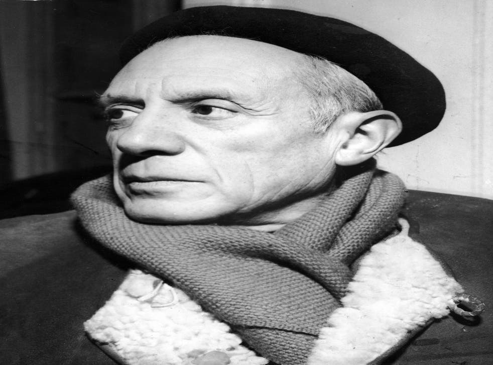 Portrait of Spanish-born artist Pablo Picasso (1881 - 1973) in a winter coat, scarf, and beret, 1950s