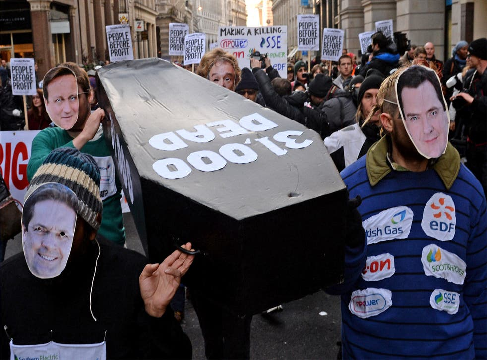 Protesters carrying a coffin to npower's offices in London to highlight the number of deaths linked to the cold weather