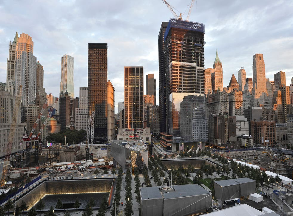 The Ground Zero memorial, surrounded by the sksycrapers of Manhattan