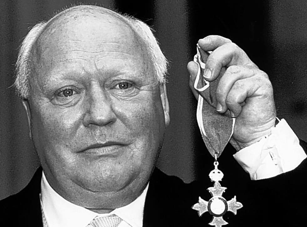 Hitchen receives his CBE in 1990; he later served on the Media Honours Committee