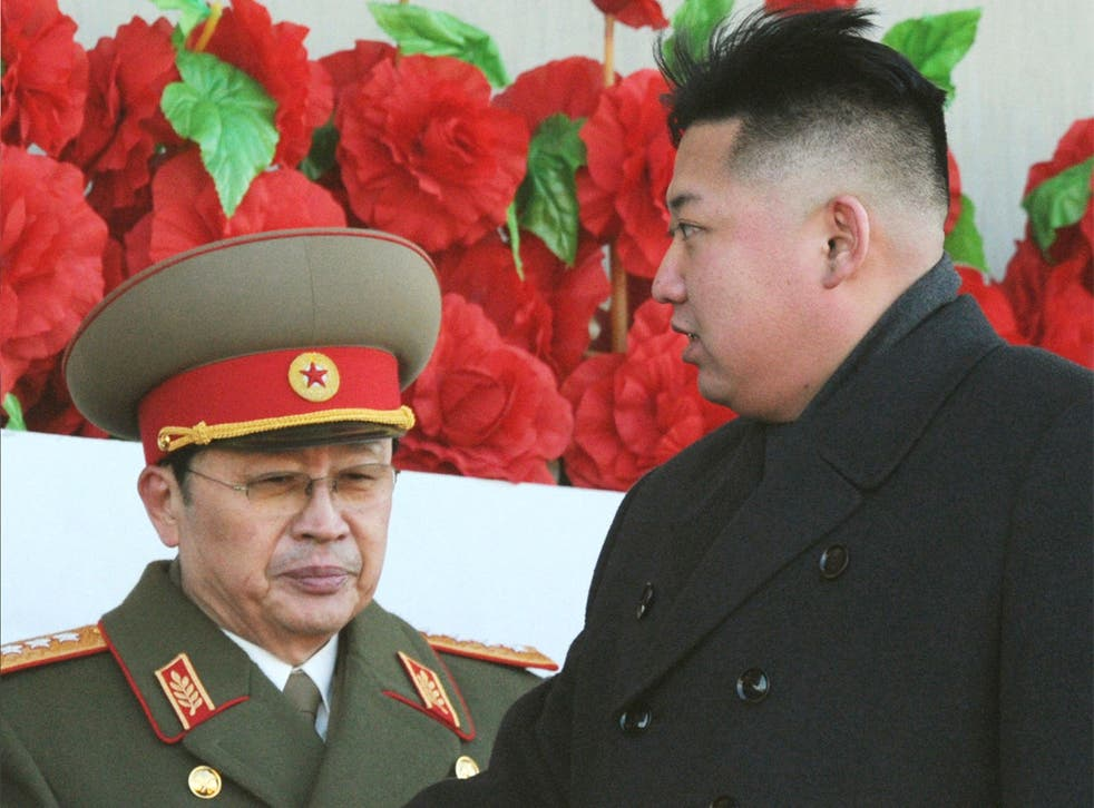North Korean leader Kim Jong Un (right) pictured with his uncle, Jang Song Thaek, earlier this year