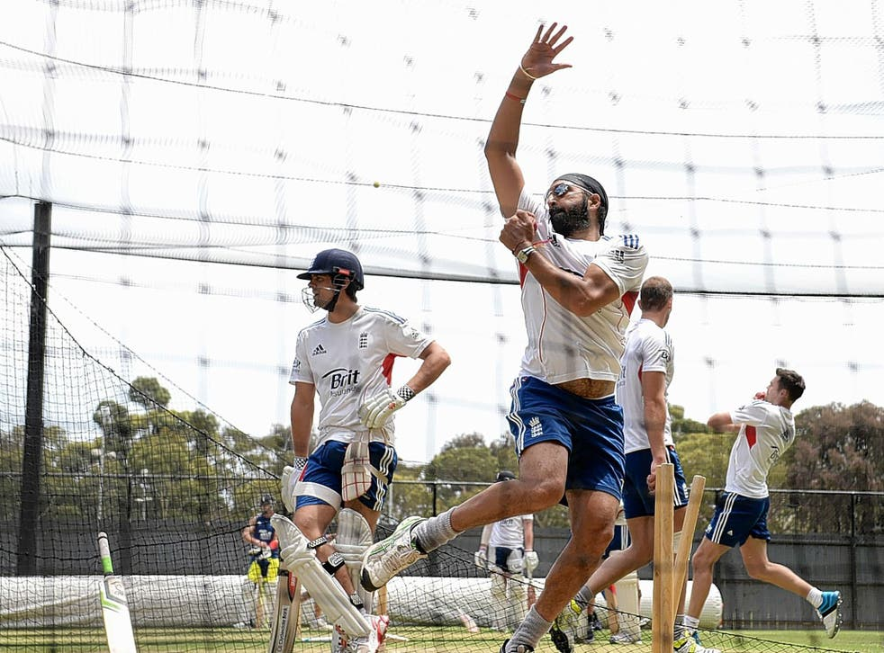 Monty Panesar bowls in the nets at Adelaide as Alastair Cook looks on