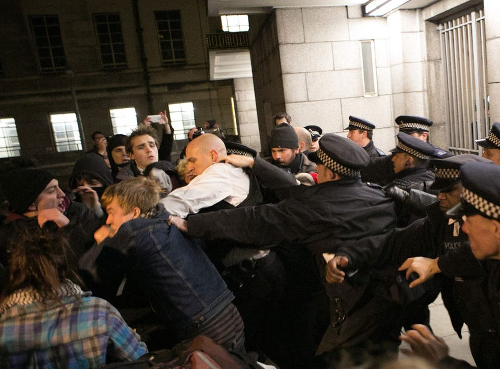 Police clash with students in London at the gates of Senate House