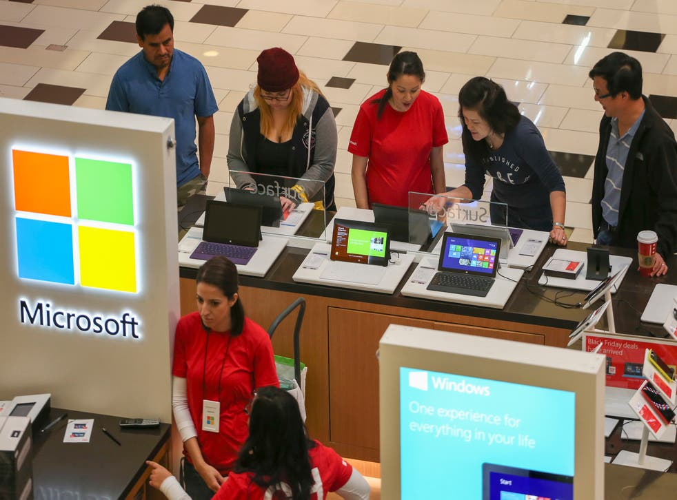 Black Friday shoppers check out Microsoft Surface tablets at the Glendale Galleria in Glendale, California November 29, 2013