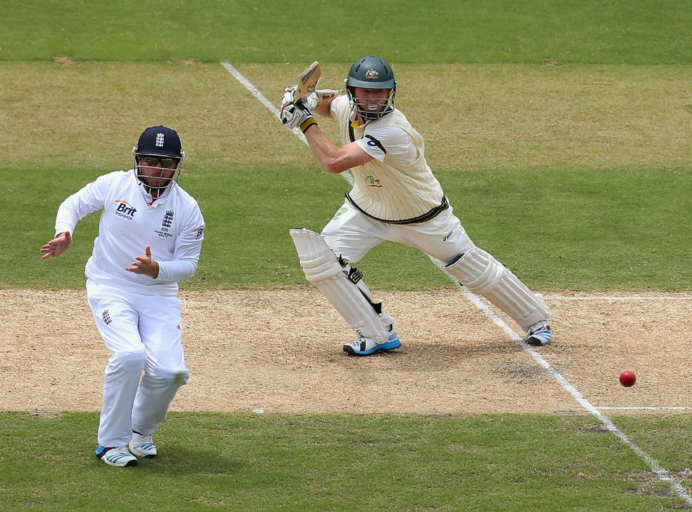 Chris Rogers hits a shot past Ian Bell on his way to 76