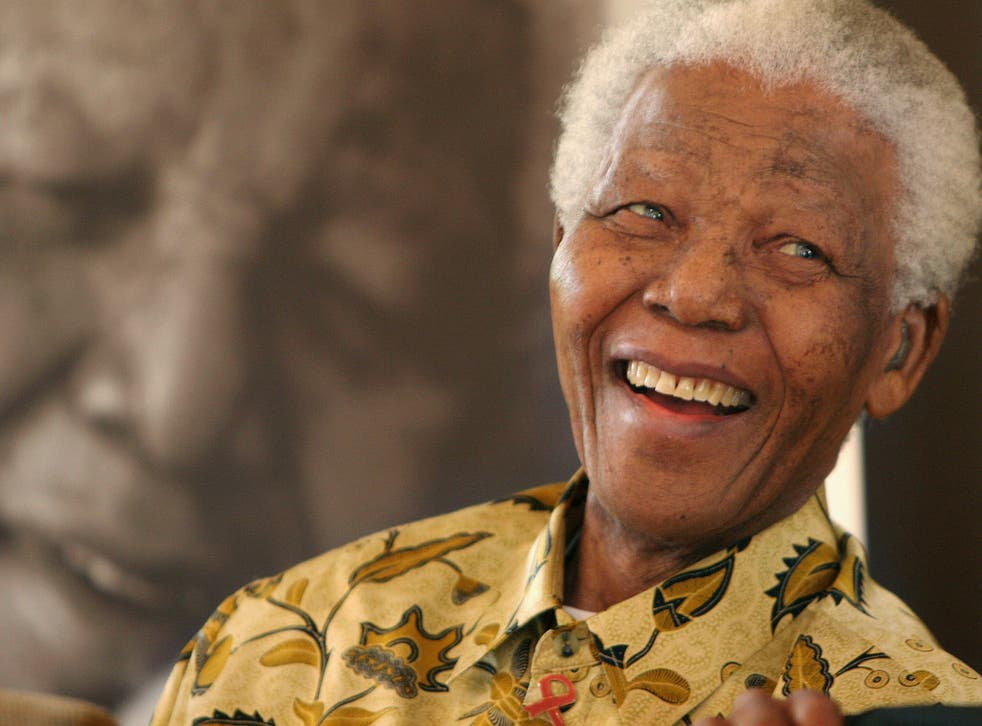 """Dec 7, 2005: Nelson Mandela at 87 at the Mandela Foundation in Johannesburg, where he met with the winner and runner-up of the local """"Idols"""" competition"""