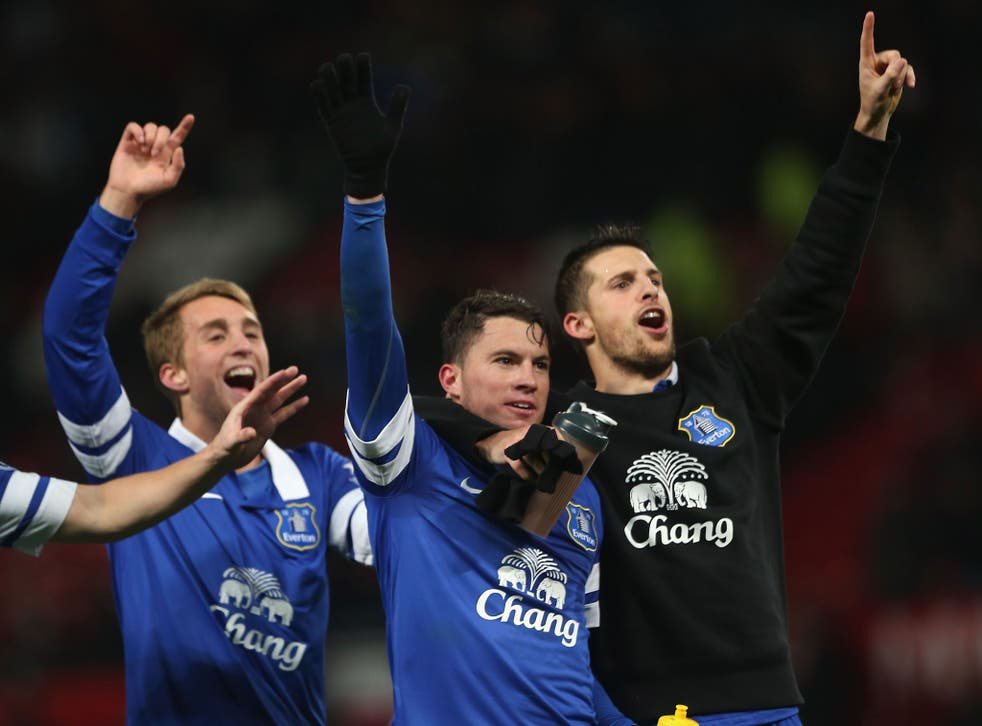 Everton players celebrate their win over Manchester United after Bryan Oviedo's (C) late winner