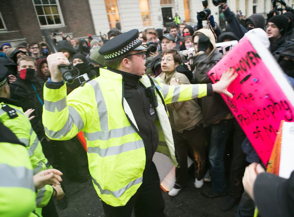 Police clash with student protesters at the University of London yesterday