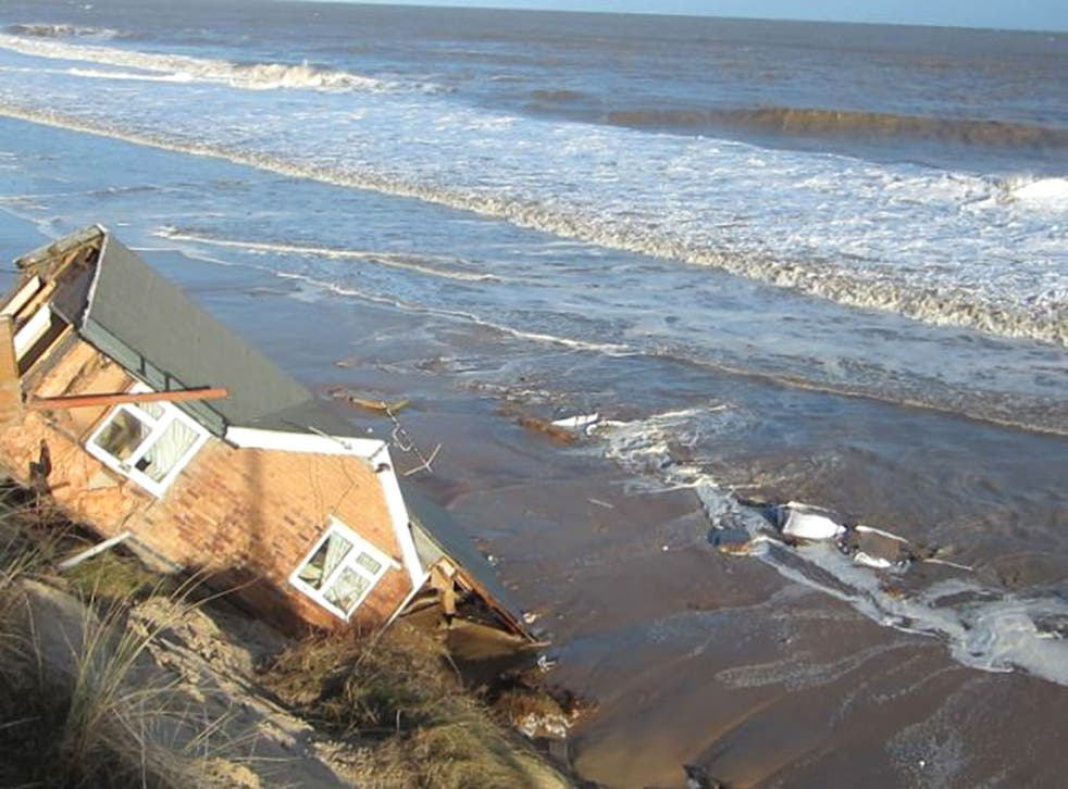 One of the five bungalows in Hemsby, Norfolk which fell into the sea last night as the tidal surge caused the cliff to break up