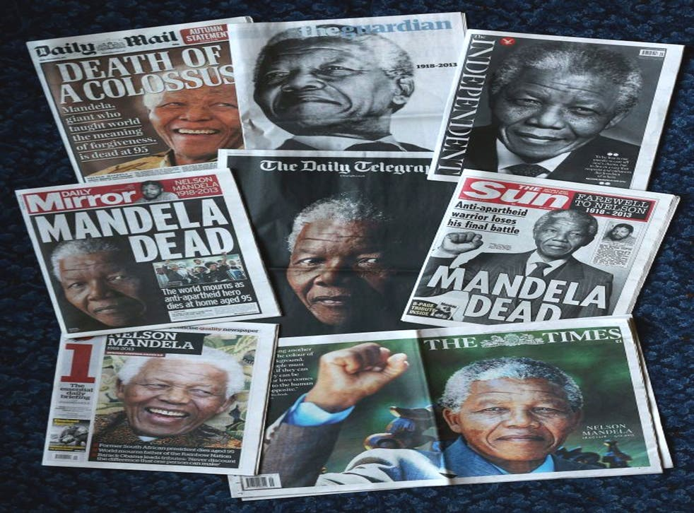 The front pages of British newspapers report on the death of former South African President Nelson Mandela in London, England